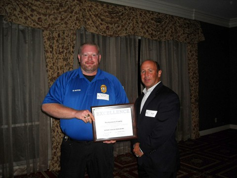 Montgomery County Animal Control Officer Matt Heaton (Right) accepts the Public Safety Award from GNRC President Scott Foster (Left) at the annual awards banquet.