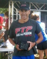 Russ Shemberger of RPM Massage in Clarksville accepts his first-place age group award in the half-iron distance at the annual Riverbluff Triathlon held Saturday, September 7th in Ashland City, TN.