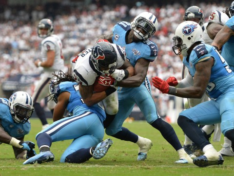 Houston Texans running back Arian Foster (23) rushes for a touchdown against the Tennessee Titans during their first meeting this year at Reliant Stadium. The Texans won 30-24:(Thomas Campbell-USA TODAY Sports)