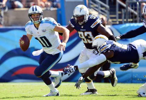 Tennessee quarterback Jake Locker eludes San Diego Charger defenders during Titans 20-17 win. (USA Today)