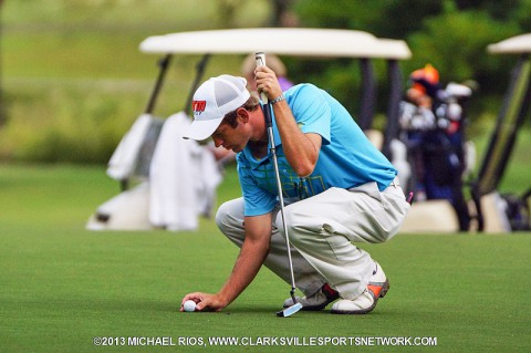 Tyler Guy prepares to putt at Swan Lake Golf Course during the first round of the Tournament of Champions.