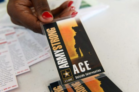 Members of the Army Suicide Prevention Program provide information about the resources available for Soldiers, Army civilians and family members, Sept. 12, 2013. Seen here is the Army ACE card that highlights the importance of three steps: asking if a person is suicidal, caring for that person and escorting that person to a professional.