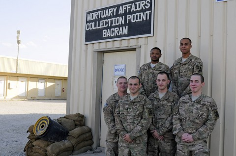The Mortuary Affairs Collection Point Bagram team stand together for a group photo, Oct. 17, 2013 at Bagram Air Field, Parwan province, Afghanistan. Sgt. Jarrett D. Ransom (top left), a native of Memphis, TN, Pfc. Shawn Thomas (top right), a native of Raeford, NC, Staff Sgt. Joel Wood (bottom left), a native of Plattsburgh, NY, Spc. Cody J. Montalbano (center left), a native of Rochester, NY, Spc. Jeremy Bennett (center right), a native of Cromwell, Ky., and Pfc. Paul Shrum (bottom right) a native of Casa Grande, AZ, are all soldiers with the 54th Quartermaster Company out of Fort Lee, VA. (U.S. Army photo by Sgt. Sinthia Rosario)