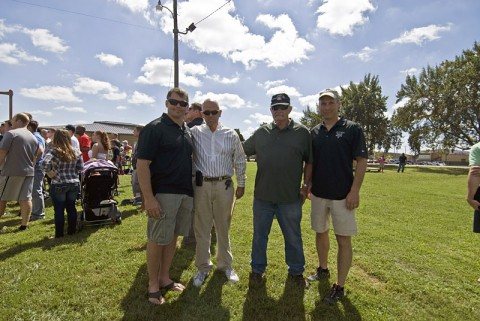 Col. John Brennan, commander of the 5th Special Forces Group (Airborne), Mr. Steve Woods, son of Staff Sgt. Lawrence Woods, Mr. Frank Roe, and Col. Frederick Prins, deputy commander of the 5th SFG (A) join together for a picture at the Group's 52nd Reunion Picnic 21 held on Gabriel Field on Fort Campbell, Ky., Sept. 21, 2013.  Approximately 49 years after Staff Sgt. Lawrence Woods, a Soldier with the 5th SFG (A) during the Vietnam War, was pronounced missing and presumed dead in Vietnam his remains were finally found just days before the Group's Reunion in Cambodia.