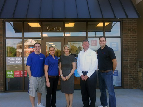 Pictured from left to right: Matt McColbey, graphic designer; Samantha Serum, visual communications specialist; Catherine Monson, CEO of FASTSIGNS International, Inc.; Lincoln Barnard, owner; Denny Fry, marketing and media manager.