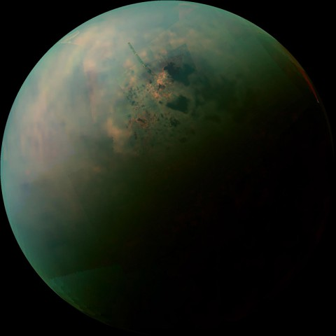 This false-color mosaic, made from infrared data collected by NASA's Cassini spacecraft, reveals the differences in the composition of surface materials around hydrocarbon lakes at Titan, Saturn's largest moon. (NASA/JPL-Caltech/University of Arizona/University of Idaho)
