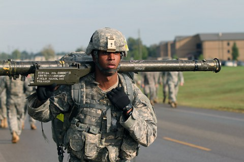 Sgt. Gregory Brookes, an Avenger team chief from Battery C, 2nd Battalion, 44th Air Defense Artillery, 101st Sustainment Brigade, 101st Airborne Division (Air Assault), carries approximately 80 pounds of gear including a Stinger missile simulator during the last stretch of a 12-mile road march Oct. 3, at Fort Campbell, Ky. The road march was the last event in a competition to determine the best Stinger missile team in the battalion. (U.S. Army photo by Sgt. Leejay Lockhart, 101st Sustainment Brigade Public Affairs)