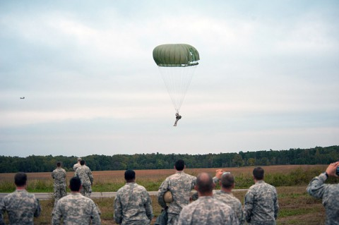 The last jumper from F Company, 5th Battalion, 101st Combat Aviation Brigade, 101st Airborne Division (Air Assault,) Pathfinders, parachutes into the drop zone to the cheers of his fellow companymates during the last jump of the Pathfinder company at Fort Campbell, Ky., Oct. 16, 2013. The jump was the last airborne operation in the history of the 101st Airborne Division. (U.S. Army photo by Sgt. Duncan Brennan, 101st CAB Public Affairs)