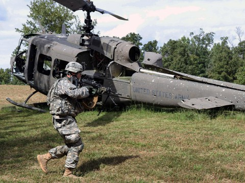 Pfc. Shea Simpson, an infantryman assigned to Company C, 3rd Battalion, 187th Infantry Regiment, 3rd BCT, 101st ABN DIV (AASLT) assaults an objective during a fire team exercise at U.S. Army Fort Campbell, Ky., Sept. 24, 2013. The team exercise was one event that soldiers had to complete during a three day field training exercise, designed to strengthen the battalion's fire teams. (Spc. Brian Smith-Dutton 3/101 Public Affairs)