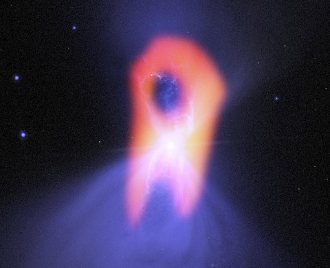 "The Boomerang nebula, called the ""coldest place in the universe,"" reveals its true shape to the Atacama Large Millimeter/submillimeter Array (ALMA) telescope. (NRAO/AUI/NSF/NASA/STScI/JPL-Caltech)"