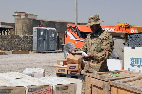 Sgt. 1st Class Charles A. Davis, a native of Birmingham, AL, and an accountable officer, verifies the material release order form for a package received at the Supply Storage Activity warehouse, Sept. 17, 2013, at Forward Operating Base Phoenix in Kabul, Afghanistan. This process is to ensure the equipment and quantity matches the MRO. (Sgt. Sinthia Rosario, Task Force Lifeliner Public Affairs)