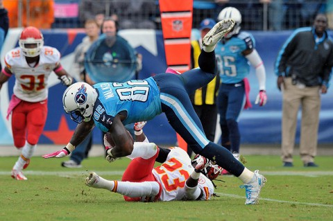 Tennessee Titans tight end Delanie Walker (82) leaps for yardage against Kansas City Chiefs free safety Kendrick Lewis (23) during the second half at LP Field. Kansas City won 26-17 on October 6, 2013. (Jim Brown-USA TODAY Sports)