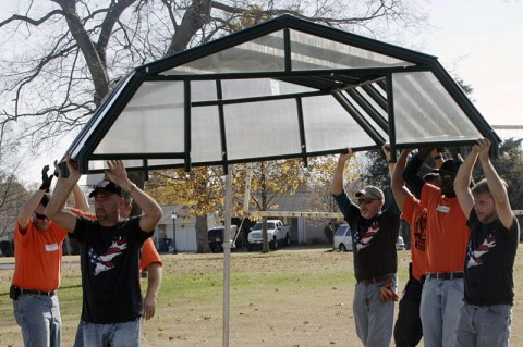 Volunteers working on the Greenhouse for the War Garden Project at Fort Campbell, KY.