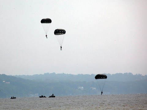 Green Berets from the 5th Special Forces Group (Airborne) parachute into a water drop zone marking the beginning of a two-day long competition testing their abilities as an Operational Detachment Alpha. (Photo by Spc. Seth Plagenza)