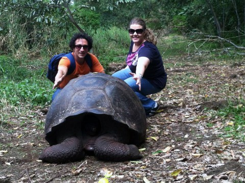 Osvaldo Di Paolo and Marissa Chandler examine a rather large tortoise while in the Galapagos Islands.