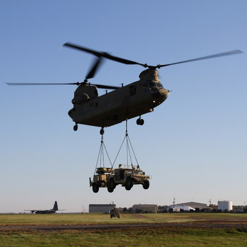 A CH-47 Chinook helicopters from Company B, 6th Battalion, 101st Combat Aviation Brigade, 101st Airborne Division (Air Assault), lifts a Humvee and a AN/MPQ-64A Sentinel radar that soldiers from Battery C, 2nd Battalion, 44th Air Defense Artillery, 101st Sustainment Brigade, sling loaded to the helicopter as part of a training mission Oct. 22 at Fort Campbell, Ky.  (U.S. Army Photo by Sgt. Leejay Lockhart, 101st Sustainment Brigade Public Affairs)