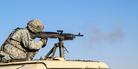 "Sgt. Kevin Veillette, a motor transport operator assigned to Troop D, 1st Squadron, 33rd Cavalry Regiment, 3rd Brigade Combat Team ""Rakkasans,"" 101st Airborne Division (Air Assault), fires a M240B Machine Gun at a qualification range on Fort Knox, Ky., Nov. 3, 2013. (Sgt. Brian Smith-Dutton /U.S. Army)"