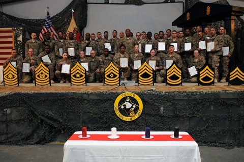 Newly promoted noncommissioned officers (NCO) pose for a group photo after completing their NCO Induction Ceremony, Oct. 30, 2013, at Bagram Air Field, Parwan province, Afghanistan. During this ceremony, the newly promoted conducted the rite of passage into the U.S. Army NCO Corps. (Sgt. Sinthia Rosario, Task Force Lifeliner Public Affairs)