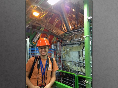 APSU student Chris Hayes stands next to the CMS detector, which is part of the Large Hadron Collider at CERN in Switzerland.