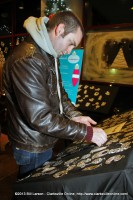 A young man looks at the Christmas ornaments on display at Christmas on the Cumberland