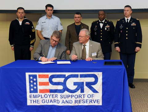 As Service Members look on, Nissan's senior vice president, administration and finance, Scott Becker (L) and ESGR National Chair, Paul Mock sign the Statement of Support on Wednesday, Nov. 13th, 2013 at Nissan America Headquarters in Franklin, TN.