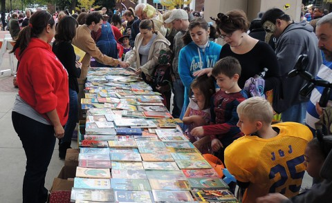 Families look through free books as part of APSU's Phi Kappa Phi chapter's annual Candy for the Mind Project.