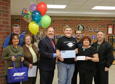Rossview High School Student Brandon Anderson recieves $1,000 prize for License Plate Design.