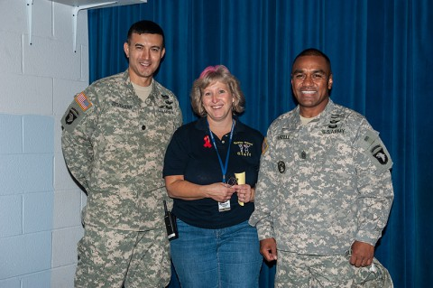 Lt. Col. Dave Zimmerman, commander, and Command Sgt. Maj. Galu P. Satele, 6th Battalion, 101st Combat Aviation Brigade, 101st Airborne Division (Air Assault), stand with Jerri Huber, co-chair of the Barclay Elementary fall festival on Fort Campbell, Ky., Oct. 25, 2013. (Sgt. Duncan Brennan, 101st CAB Public Affairs)