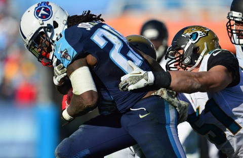 Tennessee Titans running back Chris Johnson (28) is tackled by Jacksonville Jaguars linebacker Paul Posluszny (51) during the second half at LP Field. The Jaguars beat the Titans 29-27. (Don McPeak-USA TODAY Sports)
