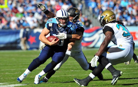 Tennessee Titans quarterback Jake Locker (10) injured his foot during a run against the Jacksonville Jaguars in the second quarter at LP Field. The Jaguars beat the Titans 29-27. (Don McPeak-USA TODAY Sports)
