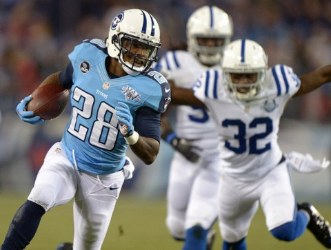 Tennessee Titans running back Chris Johnson (28) is pursued by Indianapolis Colts cornerback Cassius Vaughn (32) on a 30-yard touchdown run in the first quarter against the Indianapolis Colts at LP Field. (Kirby Lee-USA TODAY Sports)