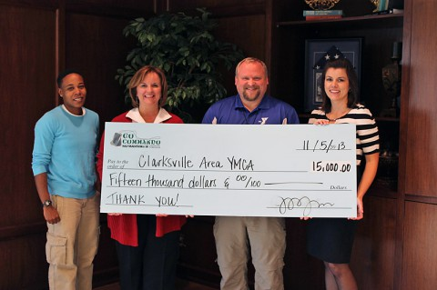 """YMCA check was accepted by James """"O'Bee"""" O'Bryant, Executive Director of the Clarksville Area YMCA. From L to R: Channel Lemon, Race Director; Christy Batts, CDE Lightband; James """"O'Bee"""" O'Bryant; Jessica Goldberg, Race Director."""