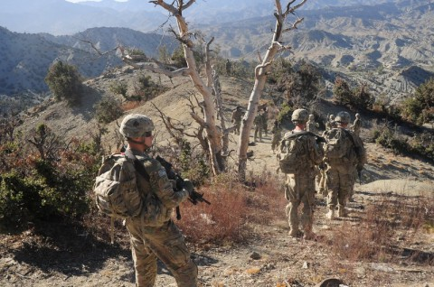 "Currahees with 1st Platoon, 1st Battalion, 506th Infantry Regiment ""Red Currahee,"" 4th Brigade Combat Team, 101st Airborne Division (Air Assault), walk down the mountain following the Afghan National Army soldiers with 6th Khandak, 1st Brigade, 203rd Corps, after a joint patrol into the mountains around Combat Outpost Wilderness, Afghanistan, Oct. 21, 2013. (U.S. Army photo by Staff Sgt. Todd A. Christopherson, 4th Brigade Combat Team Public Affairs)"