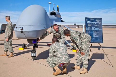 Soldiers from E Company, 160th Special Operations Aviation Regiment (Airborne), explain the capabilities of the MQ-1C Gray Eagle Unmanned Aircraft System at their activation ceremony Nov. 19, 2013.(Army photo)