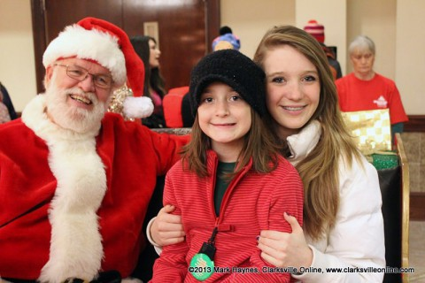 Children sat on the sleigh with Santa and told him about all the toys they wanted for Christmas at the Montgomery County Tree Lighting Ceremony.