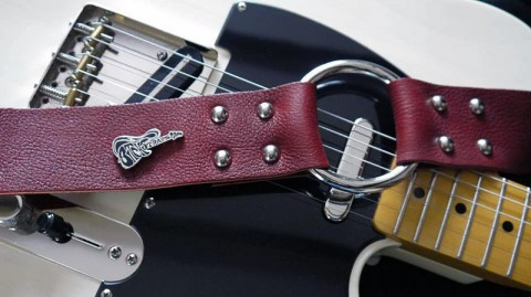 Bitchstraps - custom-made leather guitar strap.