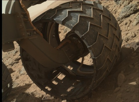 The left-front wheel of NASA's Curiosity Mars rover