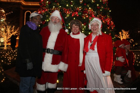 Khandra Smalley of F&M Bank with Santa and Mrs. Claus and Clarksville Mayor Kim McMillan