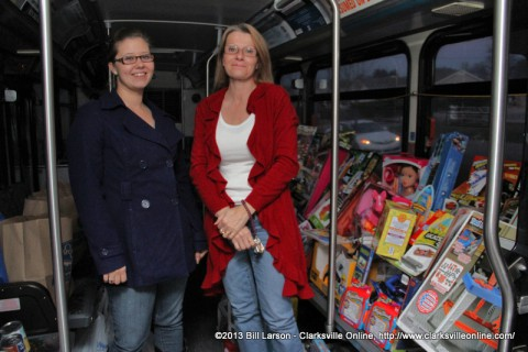 Rachel Rainey and Lori Mahaffey from Movement Mortgage with the donations for the Stuff the Bus Campaign