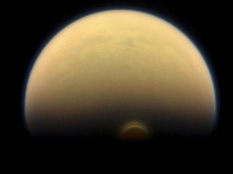 Slipping into shadow, the south polar vortex at Saturn's moon Titan still stands out against the orange and blue haze layers that are characteristic of Titan's atmosphere. (NASA/JPL-Caltech/Space Science Institute)