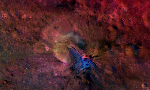 This colorful composite image from NASA's Dawn mission shows the flow of material inside and outside a crater called Aelia on the giant asteroid Vesta. The area is around 14 degrees south latitude. The images that went into this composite were obtained by Dawn's framing camera from September to October 2011. (NASA/JPL-Caltech/UCLAMPS/DLR/IDA)