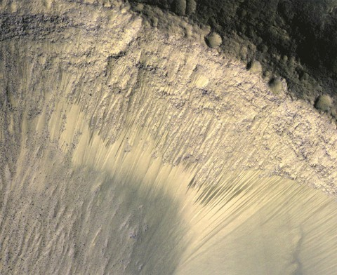 This image from the High Resolution Imaging Science Experiment (HiRISE) camera on NASA's Mars Reconnaissance Orbiter shows how the appearance of dark markings on Martian slope changes with the seasons. (NASA/JPL-Caltech/Univ. of Arizona)
