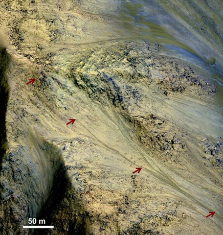 This image includes an especially long example of a type of dark marking that advances down some Martian slopes in warmer months and fades away in cooler months. (NASA/JPL-Caltech/Univ. of Arizona)