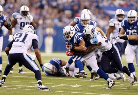 Indianapolis Colts running back Donald Brown (31) is tackled by Tennessee Titans safety Bernard Pollard (31) at Lucas Oil Stadium. Indianapolis defeats Tennessee 22-14. (Brian Spurlock-USA TODAY Sports)