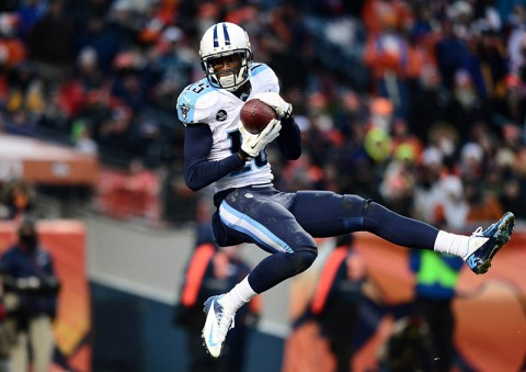 Tennessee Titans wide receiver Justin Hunter (15) pulls in a forty one yard touchdown reception in the third quarter against the Denver Broncos at Sports Authority Field at Mile High. (Ron Chenoy-USA TODAY Sports)