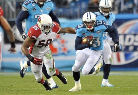 Tennessee Titans wide receiver Kendall Wright (13) rushes against Arizona Cardinals inside linebacker Daryl Washington (58) during the first half at LP Field. (Jim Brown-USA TODAY Sports)