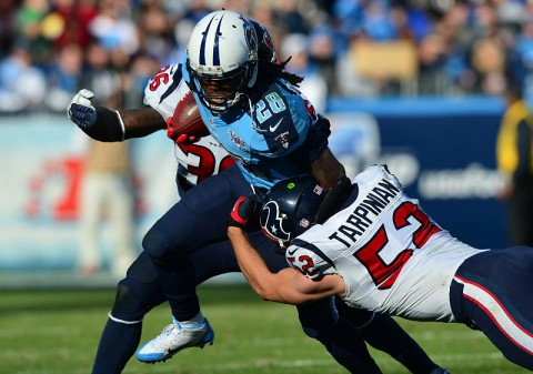 Tennessee Titans running back Chris Johnson (28) carries the ball as Houston Texans linebacker Jeff Tarpinian (52) tackles during the second half at LP Field. The Titans won 16-10. (Don McPeak-USA TODAY Sports)