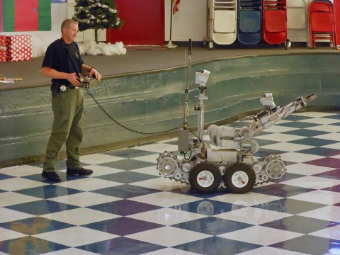 Deputy Tim Harp introduces Barksdale students to the bomb robot.