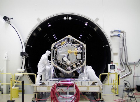 NASA's Orbiting Carbon Observatory (OCO)-2 spacecraft is moved into a thermal vacuum chamber at Orbital Sciences Corporation's Satellite Manufacturing Facility in Gilbert, Ariz., for a series of environmental tests. The tests confirmed the integrity of the observatory's electrical connections and subjected the OCO-2 instrument and spacecraft to the extreme hot, cold and airless environment they will encounter once in orbit. The observatory's solar array panels were removed prior to the test. (Orbital Sciences Corporation/NASA/JPL-Caltech)