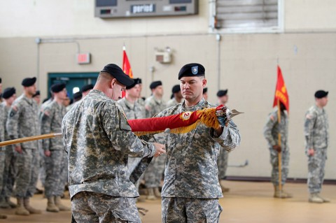 Command Sgt. Maj. Michael Brown, the senior enlisted adviser of the 2nd Battalion, 44th Air Defense Artillery Regiment (left), and Lt. Col. Timothy Shaffer, commander of the 2-44th ADA, case the battalion's colors Jan. 10 at Fort Campbell, KY. The act symbolizes the unit is ready for deployment and, when 2-44th ADA deploys later this year, it will be the battalion's sixth deployment since 2003. (U.S. Army photo by Sgt. Leejay Lockhart, 101st Sustainment Brigade Public Affairs)